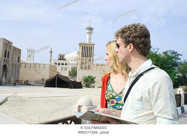 Couple looking at traditional architecture, Dubai, United Arab Emirates