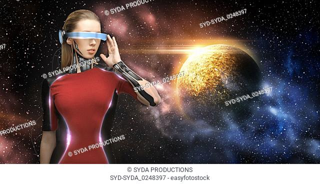 female robot in virtual reality glasses over space