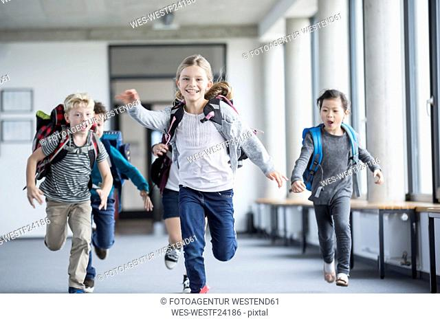 Excited pupils rushing down school corridor