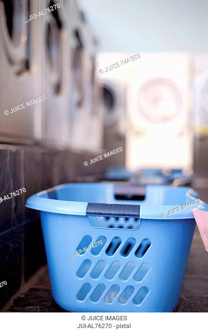Detail view of a laundry basket in a laundromat