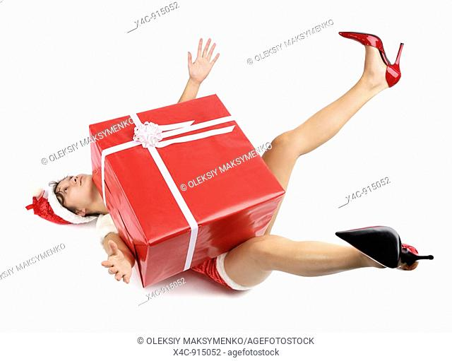 Woman pressed down with a large Christmas gift box  Isolated on white background