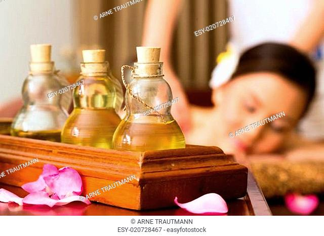 Chinese Woman at wellness massage with essential oils