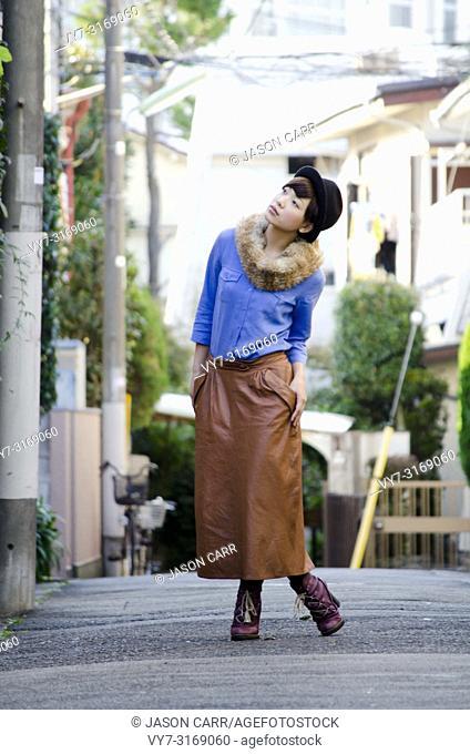 Japanese Girl poses on the street in Shimo-Kitazawa, Japan. Shimo-Kitazawa is a town located in Tokyo