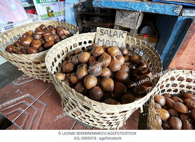 Baskets full of Salak, or Snake Fruit (Scientific name: Salacca zalacca) for sale on Malioboro street. Yogyakarta, Java, Indonesia