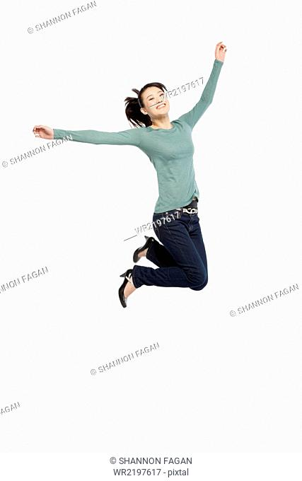 Portrait of an excited young woman mid-air