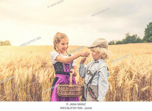 Germany, Saxony, two children standing in front of a grain field