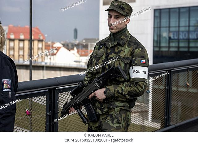 Police officers and soldiers patrol the streets of Ostrava, Czech Republic, Wednesday, March 23, 2016. Authorities in Europe have tightened security at airports