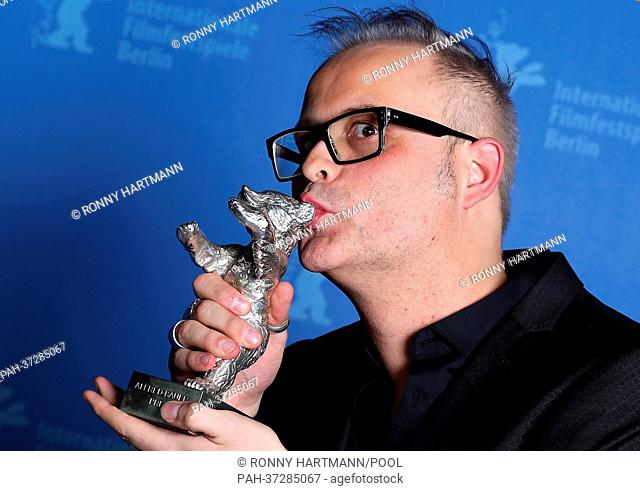 """Canadian director Denis Côté winner of the Alfred Bauer Prize, Silver Bear, for the film """"""""Vic+Flo ont vu un ours"""""""" poses during the photo call of the award..."""