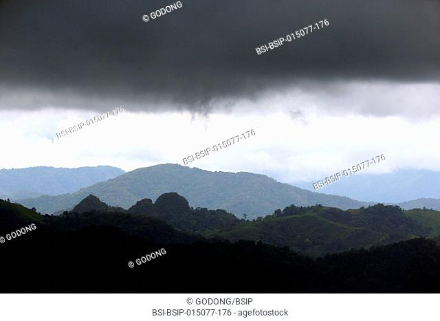 Vientiane Province. Rainy season. Moutains and black clouds