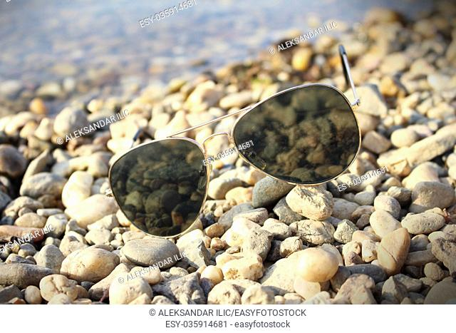 Sunglasses resting on the beach