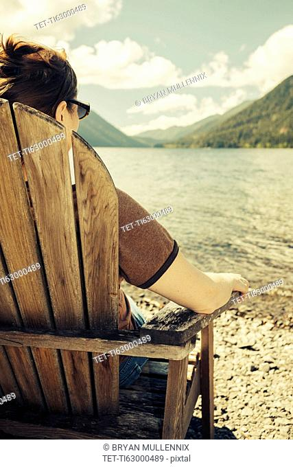 Mature woman relaxing and looking at Lake Crescent