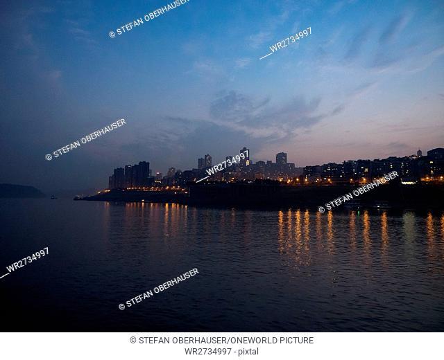 China, Chongqing, river cruise on the Yangtze River, Illuminated city of Zhongxian over the Yangtze River