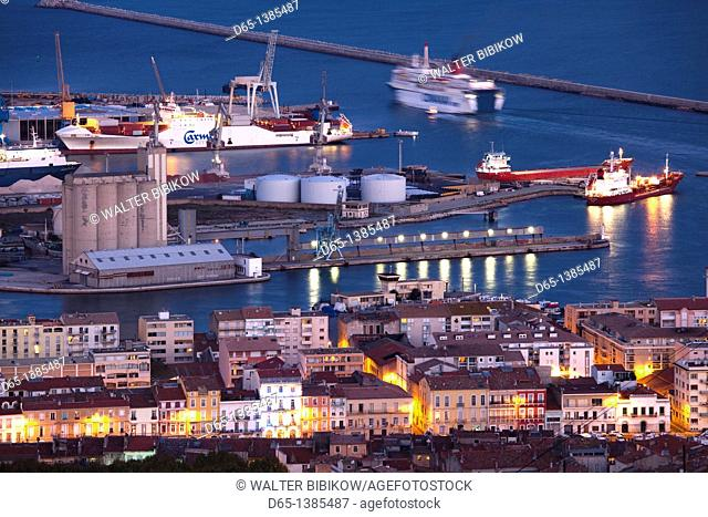 France, Languedoc-Roussillon, Herault Department, Sete, port overview from Mont St-Clair, dusk