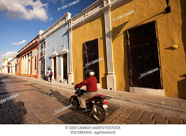 Motorcyclist in front of the colonial houses in the historic center, Campeche, Campeche State, Mexico, Central America