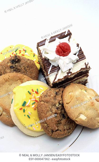 Assorted cookies and chocolate layered cake