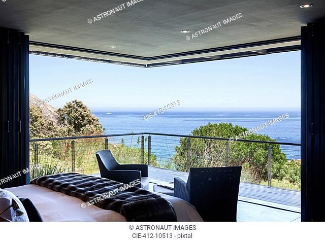 Luxury bedroom and balcony overlooking ocean