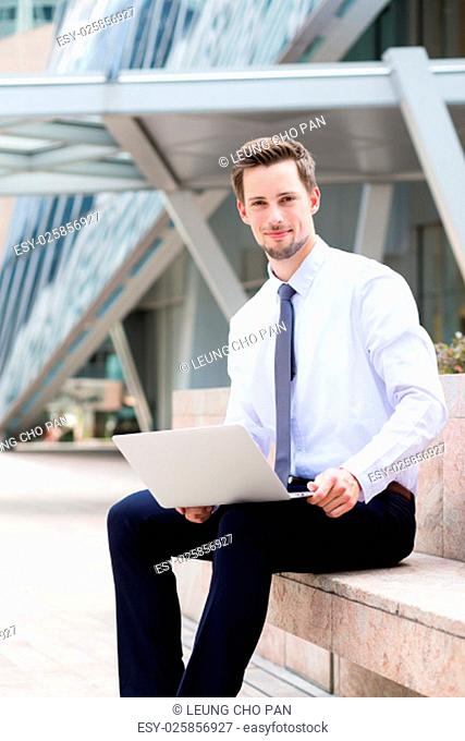 Caucasian young businessman use of the laptop computer