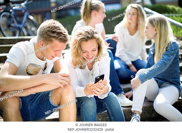 Friends sitting on steps together