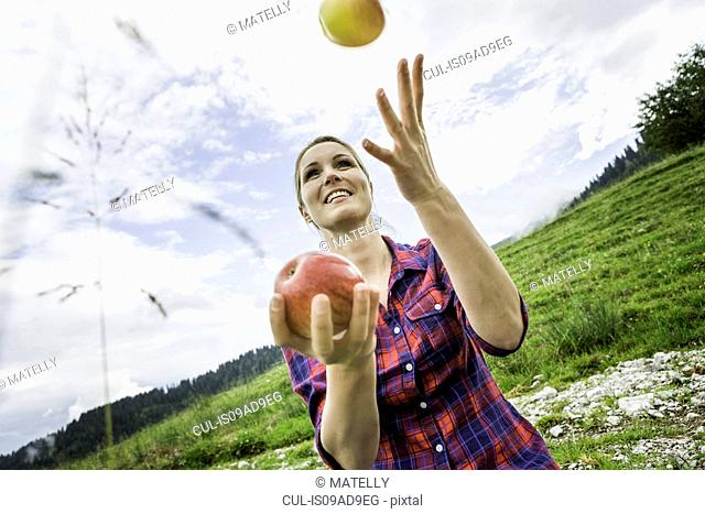 Woman juggling apples