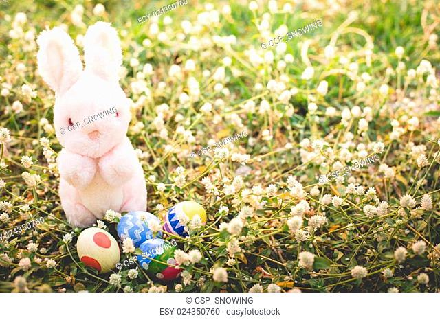 Sugar rabbit and easter eggs on meadow