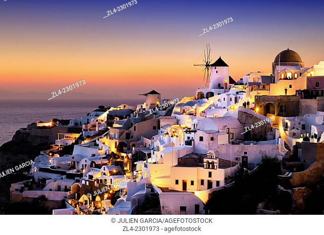 Windmills and village of Oia at sunset. Greece, Greek islands in the Aegean sea, the Cyclades, Santorini island (Thera, Thira)