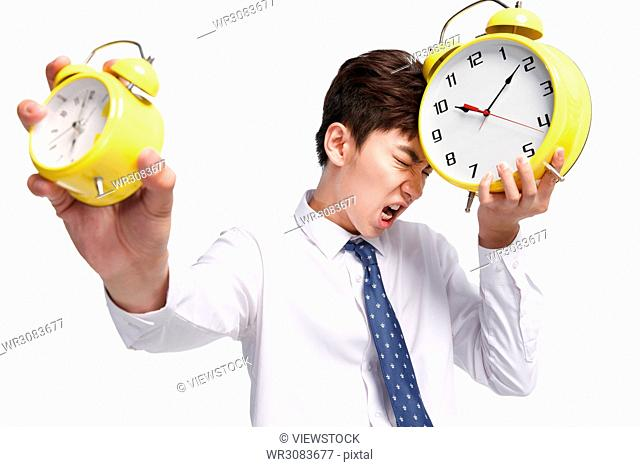 Business young man with an alarm clock