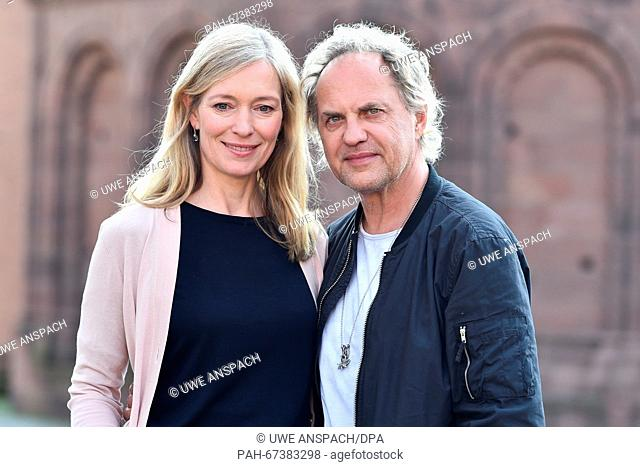 Actors Katja Weitzenboeck and Uwe Ochsenknecht stand in front of the cathedral ahead of a press conference on the Nibelung Festival in Worms