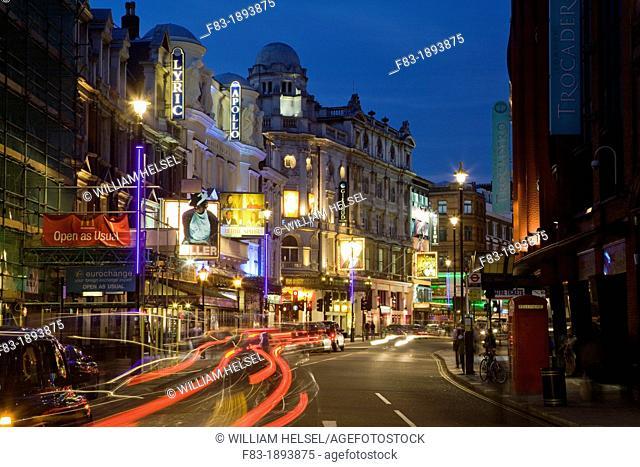 Shaftesbury Avenue theatre district, West End, London, England, with car light streaks, dusk