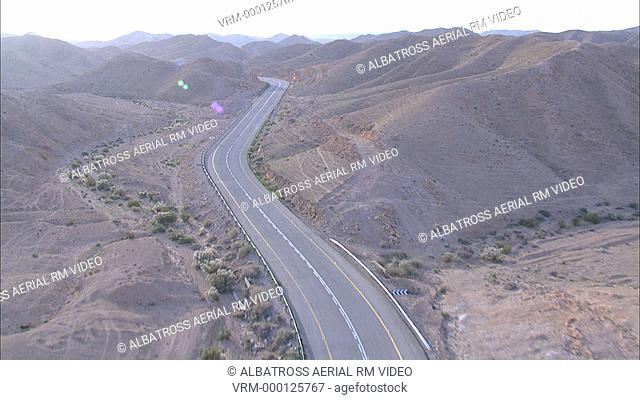 Aerial footage of a road in the Desert