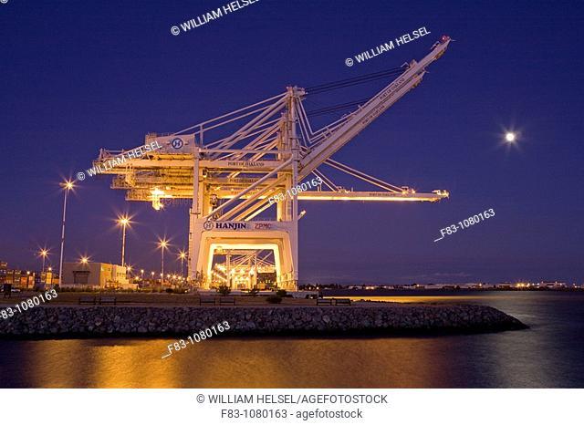 USA, California, Alameda County, San Francisco Bay Area, Port of Oakland, Alameda Estuary, container gantry cranes, at dusk, full moon rising