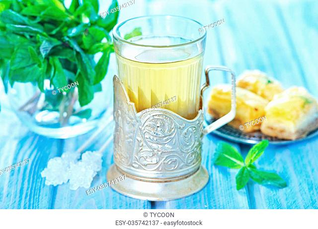 mint tea in glass and on a table