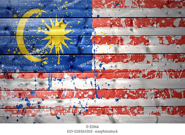 colorful painted malaysian flag on a wooden texture