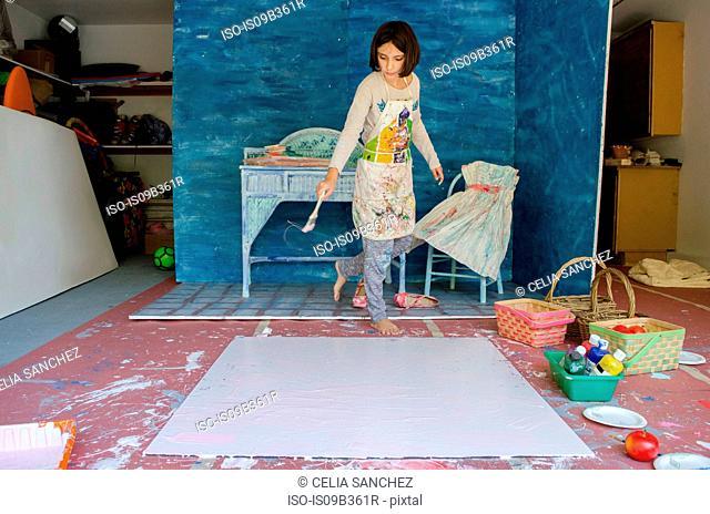 Girl in garage creating set design