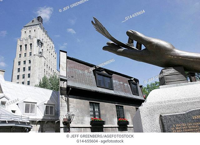 Canada, Quebec City, Upper Town, Rue Donnacona, sculpture, hand, feather, honors women, Edifice Price
