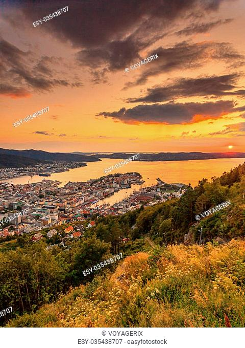 Cityspace. Panoramic view from hill of whole Bergen and fjord landscape sunset scenery, Norway