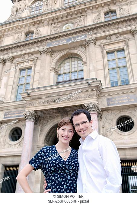 Happy couple outside the Louvre Paris