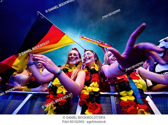 Germany fans cheer during the FIFA World Cup 2014 Semifinal match between Germany and Brazil at the public viewing at the Brandenburg Gate in Berlin, Germany