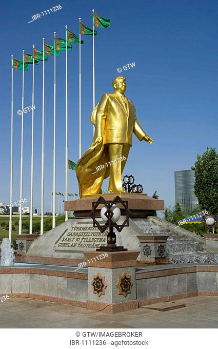 Gold covered statue of President Turkmenbasy in front of the monument of the 10th anniversary of Independence, Ashgabat, Turkmenistan