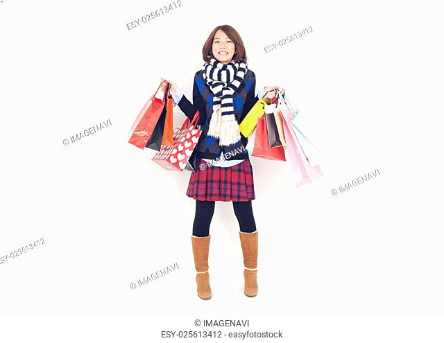 Young woman holding paper bags