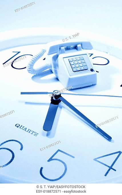 Miniature telephone on clock