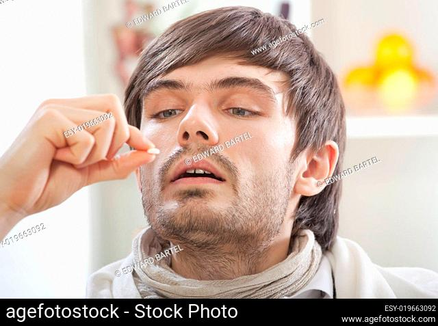 sick man taking pills
