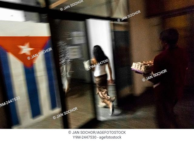 Cuban family members, carrying sweet cakes, enter the apartment block in Alamar, a public housing complex in the Eastern Havana, Cuba, 14 February 2009