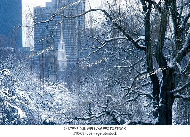 Winter view through Public Garden and Boston Common to Park St., Boston, Massachusetts. USA
