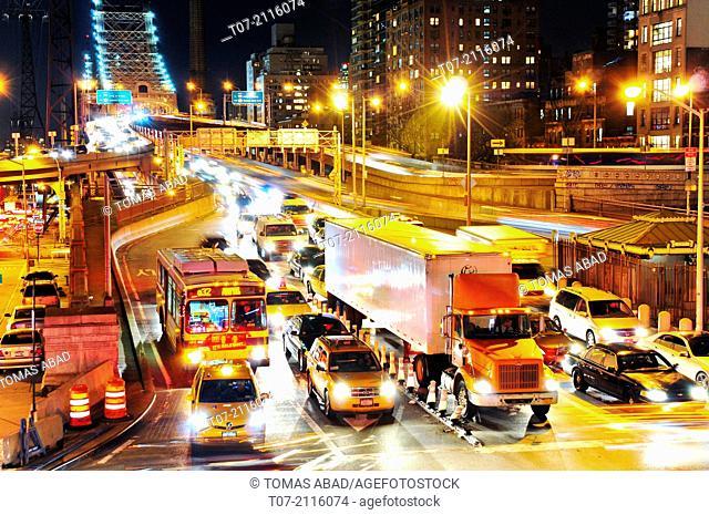 Evening rush hour traffic exiting the Ed Koch Queensborough 59th Street Bridge, midtown Manhattan, east side, Manhattan, New York City, USA