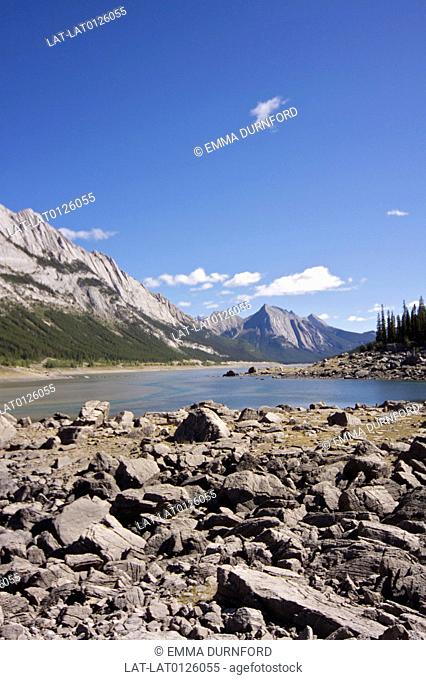 The Jasper national park in the Canadian Rockies is a large area of protected landscape including the Maligne river which flows into Medicine lake