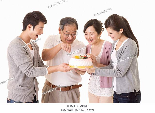Two generation family celebrating birthday with smile together
