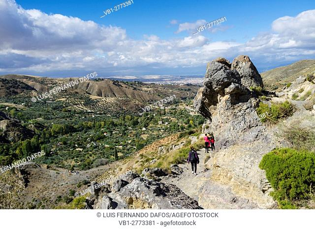 Hikers at Los Cahorros trail, Monachil. Granada province, Andalusia, Spain