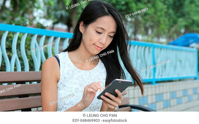 Woman using mobile phone for payment