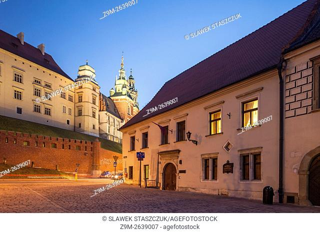 Night falls on Grodzka street in Krakow old town, Malopolska, Poland. UNESCO world heritage site