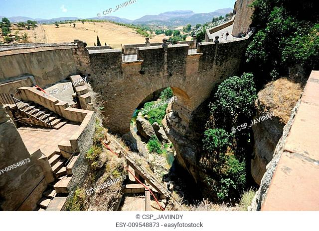 Roman bridge in Ronda, one of the famous white villages in Mála